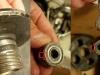 Wyrobiona bieżnia simmeringu na zabieraku, wyrobiona dźwignia sprzęgła i zużyty tłoczek wycisku.