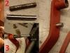 Etapy naprawy konsoli z pedałami: toczenie nadwymiarowej osi, rozwiercanie, toczenie i wspawanie nadwymiarowych kołków popychaczy...   /   Pedal repair stages
